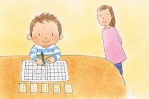小学生低学年の男の子が読書感想文を書くイラスト